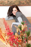 Beautiful brunette relaxing on the sofa Royalty Free Stock Photo