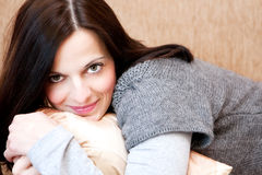 Beautiful brunette relaxing on the sofa Royalty Free Stock Photos