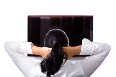 Beautiful brunette is relaxing at the TV Royalty Free Stock Photography