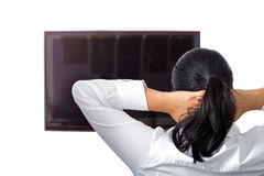 Beautiful brunette is resting at the TV Stock Photography
