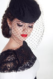 Beautiful brunette retro woman portrait in elegant hat with red Stock Image