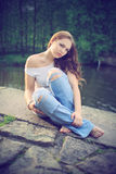 Beautiful brunette at the river Royalty Free Stock Image