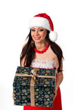 Beautiful brunette Santa Girl with Christmas present in hands on Stock Images