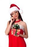 Beautiful brunette Santa Girl  guesses  gift Royalty Free Stock Photo