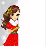 Beautiful Brunette Santa Girl Holding Banner Royalty Free Stock Photography