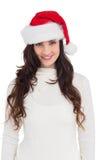 Beautiful brunette in santa hat smiling at camera Stock Images