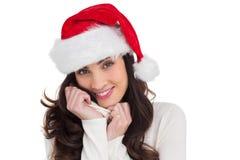 Beautiful brunette in santa hat smiling at camera Royalty Free Stock Photo