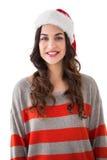 Beautiful brunette in santa hat smiling at camera Stock Photos