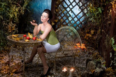 Beautiful brunette   scared girl in mystical autumn garden Stock Photos