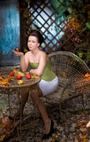 Beautiful brunette   scared girl in mystical autumn garden Royalty Free Stock Photo