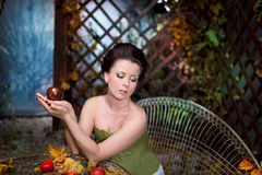 Beautiful brunette   scared girl in mystical autumn garden Royalty Free Stock Photography