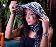 Beautiful brunette with  scarf posing Royalty Free Stock Photography