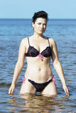Beautiful brunette in sea water Royalty Free Stock Images