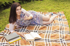 Beautiful brunette senior woman studying for her exams sitting o Royalty Free Stock Photo