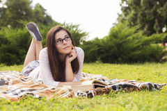 Beautiful brunette senior woman studying for her exams sitting o Royalty Free Stock Images