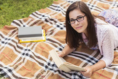 Beautiful brunette senior woman studying for her exams sitting o Royalty Free Stock Photos