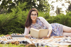 Beautiful brunette senior woman studying for her exams sitting o Stock Photo