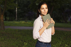 Beautiful brunette senior woman studying for her exams standing Royalty Free Stock Photography