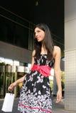Beautiful brunette shopaholic outdoor city Stock Photos