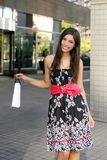 Beautiful brunette shopaholic outdoor city Royalty Free Stock Image
