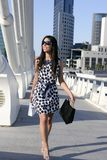 Beautiful brunette shopaholic outdoor city stock image
