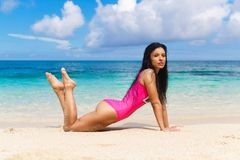 Beautiful brunette on the shore of a tropical beach. Summer vaca royalty free stock images