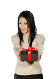 Beautiful brunette showing a present box Royalty Free Stock Photo