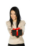 Beautiful brunette showing a present box Stock Photography
