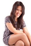 Beautiful brunette sitting on a chair Royalty Free Stock Photography