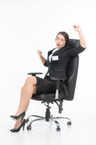 Beautiful brunette sitting in chair and stretching. Royalty Free Stock Image