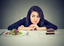 Young woman having problems with diet choice stock image