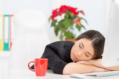 Beautiful brunette sleeping at work after break. Royalty Free Stock Images