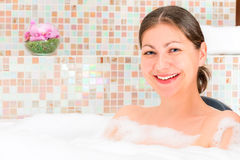 Beautiful brunette smiling in the jacuzzi Stock Photo