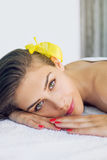 Beautiful brunette at spa treatment Stock Images