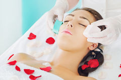 Beautiful brunette at spa treatment Stock Photos