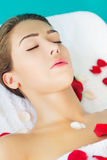 Beautiful brunette at spa treatment Stock Image