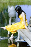 Beautiful brunette splashes water Stock Photo