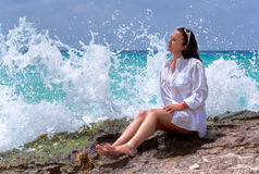 Beautiful brunette with splashing wave Royalty Free Stock Photography