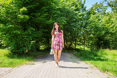 Beautiful Brunette Standing Barefoot On The Sidewalk Stock Photography