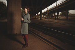 Beautiful brunette standing under the bridge Royalty Free Stock Photos