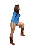 Beautiful Brunette Stepping Up Royalty Free Stock Photography