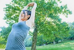 Beautiful brunette stretching on park of Camaldoli. In Italy Royalty Free Stock Images
