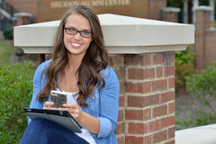 Beautiful brunette student in glasses Stock Photography