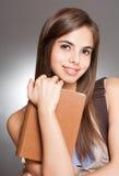 Beautiful brunette student. Stock Photo