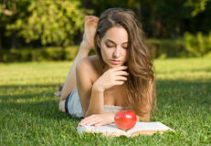 Beautiful brunette studying outdoors. Royalty Free Stock Photos