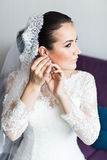 Beautiful brunette stylish bride getting ready in the morning Royalty Free Stock Images