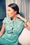Beautiful brunette in a stylish fashion dress stock image