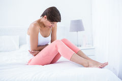 Beautiful brunette suffering from stomach pain Stock Photos