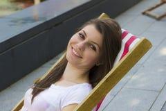 Beautiful brunette at summer beach Stock Image