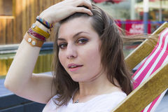 Beautiful brunette at summer beach Stock Photo